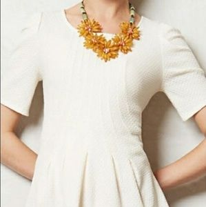 Anthropologie postage stamp knit peplum texted top